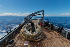 "The first ""flown"" test vehicle of Low-Density Supersonic Decelerator project relaxes aboard the recovery vessel Kahana."