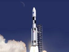 Artist concept shows NASA's Space Launch System rising from a launchpad.