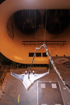 Scale model of a blended wing aircraft inside a wind tunnel.