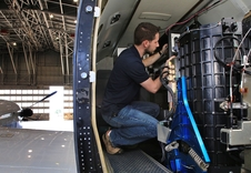 Technician Richard Martin installs instruments on NASA's UC-12 aircraft at NASA's Langley Research Center in preparation for the airborne portion of the SABOR field campaign.