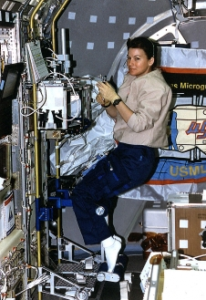 NASA astronaut Cady Coleman supports a protein crystal growth study aboard STS-73 in the Spacelab module in 1995.