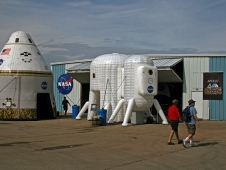 Inflatable exhibits of a lunar habitat concept and an Orion Crew capsule.