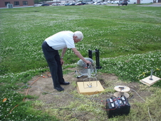 Allan Zuckerwar, co-inventor of the Extreme Low Frequency Acoustic Measurement System, conducts a wind noise reduction test in the field.