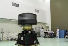 Spacecraft A, one of two Radiation Belt Storm Probes, is checked for proper balance during a spin test