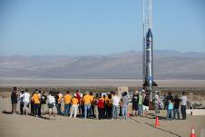 Students and engineers participate in a prelaunch briefing