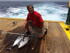 Applied scientist Maury Estes poses with blackfin tuna caught off the coast of Louisiana.