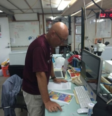 Chief scientist John Lamkin studies satellite images.