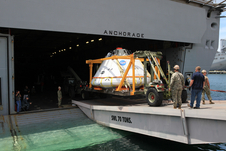 At the U.S. Naval Base San Diego in California, the Orion boilerplate test vehicle and support hardware are loaded into the well deck of the USS Anchorage for Underway Recovery Test 2 on July 29, 2014. NASA, Lockheed Martin and the U.S. Navy will conduct tests in the Pacific Ocean to prepare for recovery of the Orion from a deep space mission. This recovery test will allow the teams to demonstrate and evaluate the recovery processes in open waters.