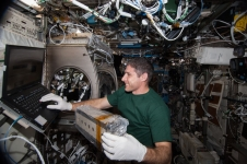Aboard the International Space Station, astronaut Mike Hopkins works with a cell array for the Selectable Optics Diagnostic Instrument-Diffusion Coefficient in Mixtures 2 (SODI-DCMIX 2) investigation. Findings may help refine petroleum reservoir models for more efficient extraction of oil resources.