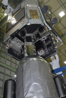 Photo of SDO spacecraft being lowered onto the propulsion module.