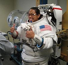 Jonnie Yaptengco gives two thumbs up as she is fitted for a spacesuit