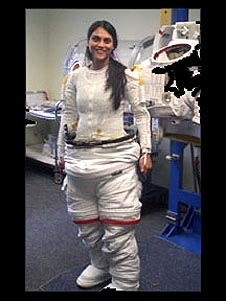 Sabrina Singh putting on a white spacesuit