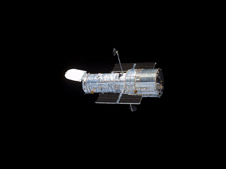 Image of Hubble floating against the blackness of space