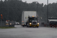 The truck carrying the SDO satellite arrived during a summertime thunderstorm's downpour.