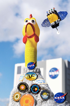 SDO mascot, Camilla (rubber chicken) and Little SDO in front of KSC Vehicle Assembly Building.