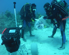NEEMO 13 Aquanauts collect and document samples.