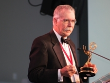 Frank Wilson accepts the Emmy Award