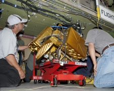Technicians prepare to install HIWRAP on the underside of a NASA Global Hawk.