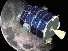 A computer-generated model of the LADEE spacecraft in front of the moon