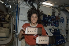 Astronaut Suni Williams with the YouTube SpaceLab payload Spider Habitat where Nefertiti the spidernaut lived while she was on orbit