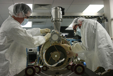University of Colorado science team work on the SLICE instrument during integration testing.