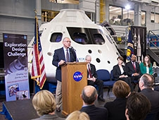 NASA's Administrator in front of the Orion capsule addressing an audience