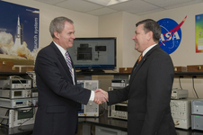 James Johnson, left, accepted software from Patrick Scheuermann, director of NASA Marshall