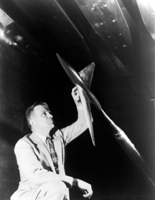 Whitcomb examines a model designed in accordance with his transonic area rule in April 1954.