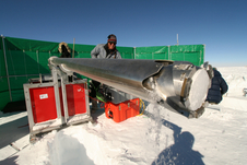 Norwegian-American Scientific Traverse of East Antarctica team member drills a shallow firn (compacted snow) core.