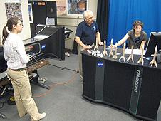 Tom Benson and two high school students testing rocket models in a wind tunnel