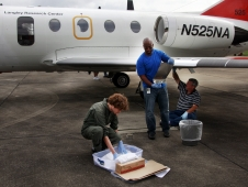 NASA's Langley Research Center researchers, prepares the non-stick coatings that will be put on portions of the wing of a research aircraft.