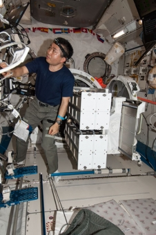 Japan Aerospace Exploration Agency astronaut Koichi Wakata prepares a batch of NanoRacks CubeSats for deployment.