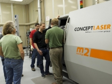 Engineers at Marshall Space Flight Center observe the new Selective Laser Melting machine.