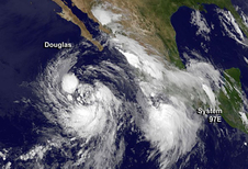 Tropical Storm Douglas being chased by developing System 97E