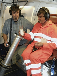 Mark Beaubien, (left) of Yankee Environmental Systems, and Lee Harrison, of the State University of New York at Albany, prepare to dispense a soda-can sized dropsonde from NASA's DC-8 flying laboratory.