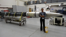 Patel in front of a sounding rocket.