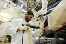 Textron technicians apply the Avcoat material