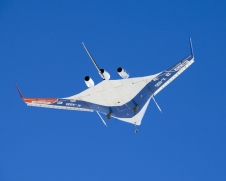 A pristine blue sky backdrops the X-48B Blended Wing Body aircraft during the aircraft's first flight, on July 20, 2007.