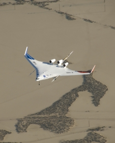 The X-48B Blended Wing Body aircraft flies over Edwards Air Force Base, Calif.
