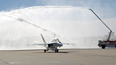 Edwards Air Force Base fire trucks unleash their water cannons in a salute to NASA research pilot Gordon Fullerton as his F/A-18 taxies in following his final NASA flight.
