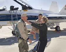 NASA Dryden research pilot Gordon Fullerton is greeted by his wife Marie on the Dryden ramp after his final flight in a NASA F/A-18 on Dec. 21, 2007.