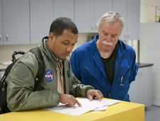 Matt Berry and Bruce Anderson reviewing the flight plan.