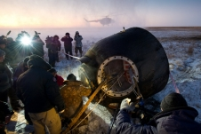Russian support personnel work to help get Expedition 29 crew members out of the Soyuz TMA-02M spacecraft shortly after landing on Tuesday, Nov. 22, 2011.