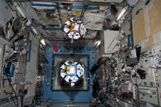 SPHERES robots on the International Space Station. The volleyball-sized satellites have their own power, propulsion and navigation systems and are used in an international competition for high school students. Each year a tournament is held where students earn points by writing control algorithms to operate the spheres and by choosing the best tactics to win the game.