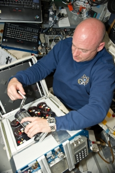 View of STS-134 Commander Mark Kelly working with Group Activation Pack (GAP) assemblies on the shuttle Flight Deck.