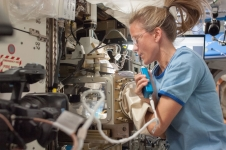 NASA astronaut Karen Nyberg works on the Advanced Colloids Experiment-M-1 at the Light Microscopy Module in the Fluids Integrated Rack / Fluids Combustion Facility during Expedition 36 aboard the International Space Station.
