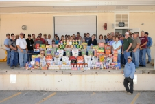 NASA White Sands Test Facility Construction Maintenance and Operations employees are proud of their generous contributions to Feds Feed Families 2011 Food Drive for local food banks and shelters.