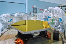 a Webb telescope mirror segment is inspected in a NASA Goddard clean room
