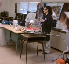 Christina Piña Arpin and Sonja Wood demonstrate to the career conference attendees how simulated space atmospheres can change ordinary earth materials by conducting experiments in vacuum where balloons deflate and shaving cream expands.