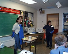 Rachel Wofford, electrical engineer, and Georgiana Bernal, electrical engineer conduct an LN2 demonstration.